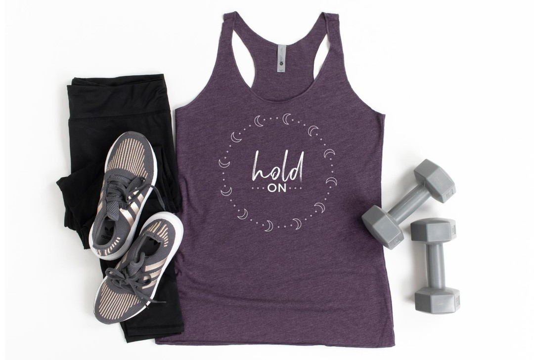 HOLD ONWe WILL get through the pain and hardships of this pandemic, even if it doesn't seem like it right now.Our shop is still open if you could use an empowering message for yourself or for a friend during this difficult time.Tanks come in Vintage Purple (pictured), Envy, and Indigo tri-blend... and are perfect for your in-home quarantine workouts. Please note, there's a slight shipping delay at our warehouse due to safety and staffing.As always, 5% of net proceeds goes to @mentalhealthamerica. Link to shop is in my bio.#ichoosebeauty #holdon #holdontight #holdontohope #quarantinelife #quarantineworkout #youvegotthis #wevegotthis #wearabletherapy #wearableart #wordsofencouragement #tanktops #athleisurewear #athleisurestyle #yogaclothes #yogastyle #workoutclothes #workoutinstyle #workoutapparel #workoutgear #workoutwear #giftsforfriends #perfectgifts #mentalhealthsupport #mentalhealthisimportant